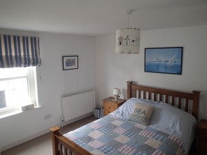 Master bedroom of holiday cottage
